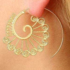 Indian tribal symbols. Round spiritual earrings.